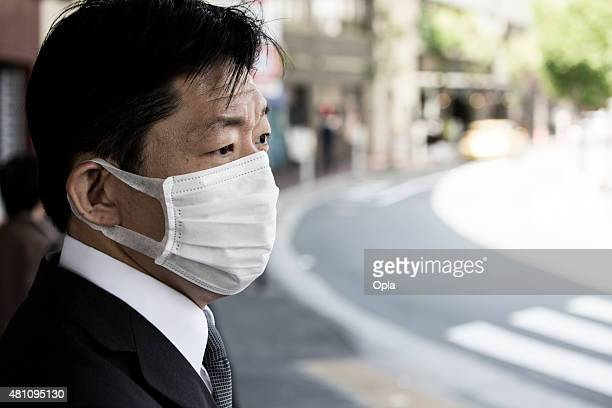 Japanese businessman wearing a face mask