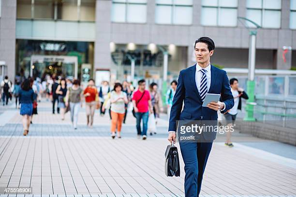 Japanese businessman with digital tablet at Tokyo street