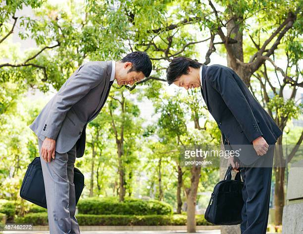 Japanese businessmen bowing to each other