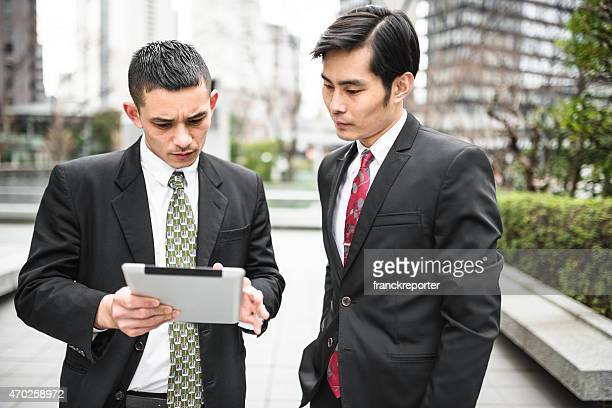 japanese Businesstalking together on the downtown