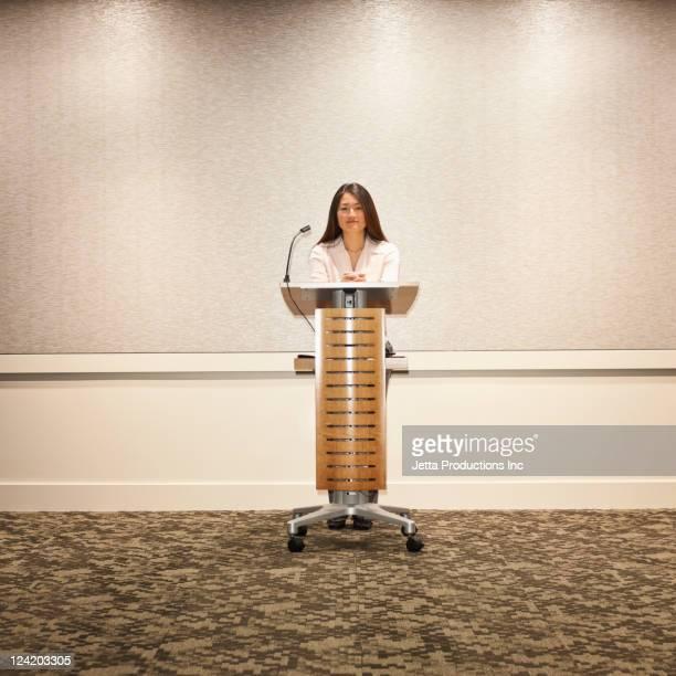 Japanese businesswoman standing at podium
