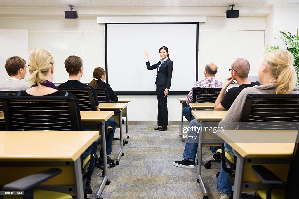 A Japanese businesswoman teaching seminar to class : Stock Photo