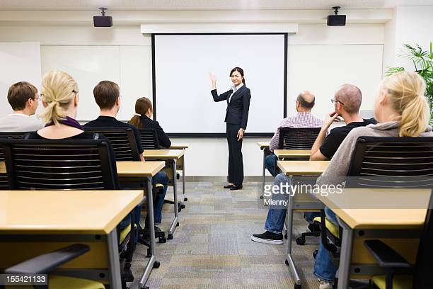 A Japanese businesswoman teaching seminar to class