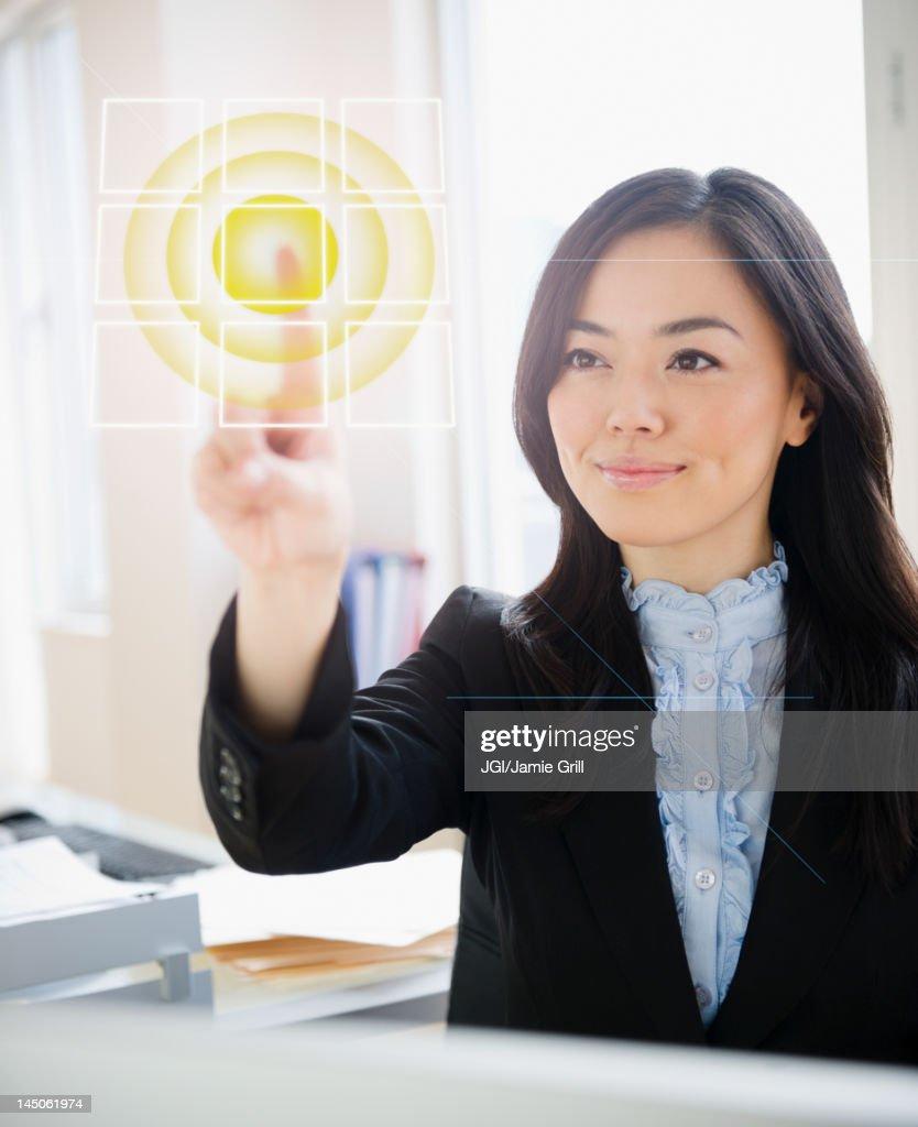Japanese businesswoman touching digital screen : Stock Photo