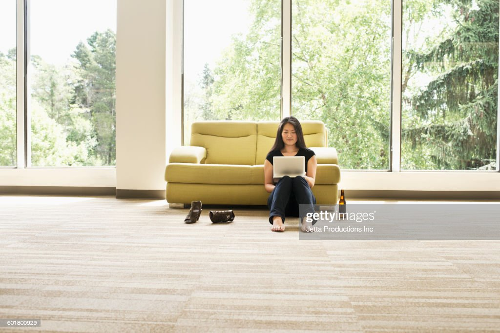 Japanese businesswoman using digital tablet in empty office