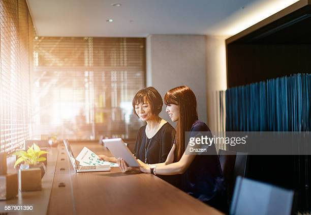 Japanese businesswomen developing business strategy