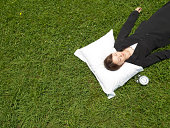 Japanese bussiness woman sleeping on the green