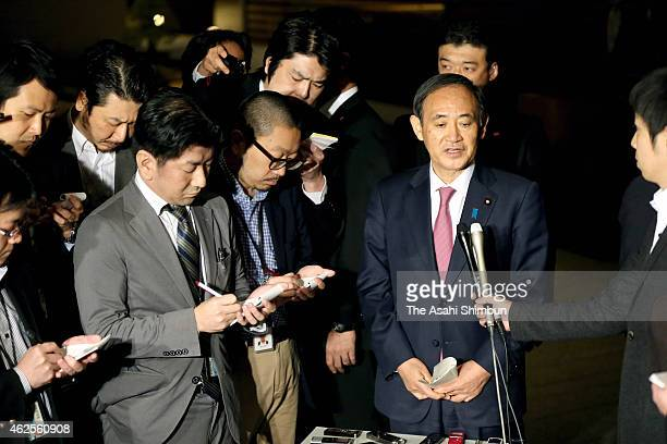 Japanese Cabinet Chief Secretary Yoshihide Suga speaks to media reporters at Prime Minister Shinzo Abe's official residence on January 31 2015 in...
