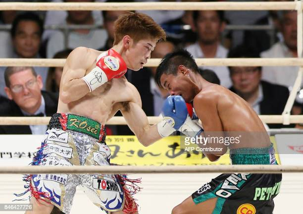 Japanese champion Kosei Tanaka fights with Thai challenger Palangpol CP Freshmart during the fourth round of the WBO light flyweight title bout in...