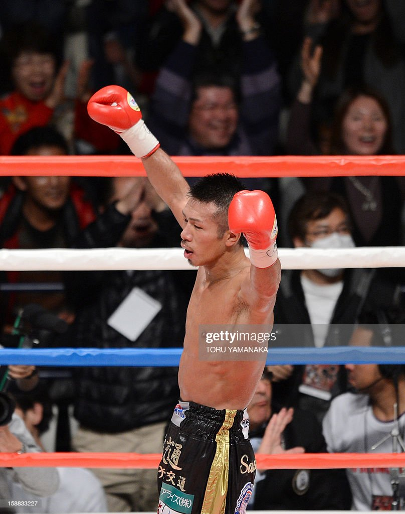 Japanese champion Takashi Uchiyama celebrates his victory over Bryan Vasquez of Costa Rica in the eighth round of their WBA super featherweight title bout in Tokyo on December 31, 2012. Uchiyama defeated Vasquez with a technical knockout to defend the title. AFP PHOTO / Toru YAMANAKA