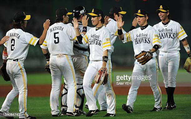 Japanese championship team Softbank Hawks celebrate after beating Taiwan championship team UniLions during the Asia Series baseball tournament in...