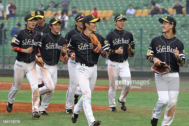 Japanese championship team Softbank Hawks celebrate after beating the South Korea champions Samsung Lions during the 2011 Asia Series baseball...