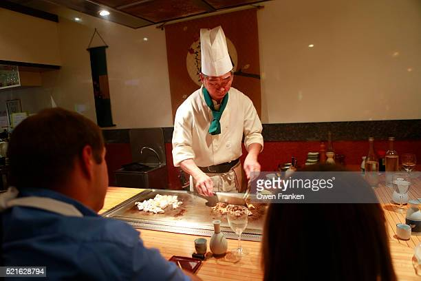 Japanese chef preparing a meal at a hibachi grill, Paris