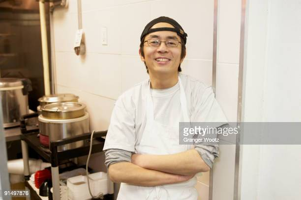 Japanese chef smiling in commercial kitchen