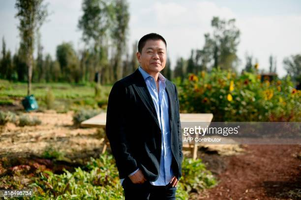 Japanese chef Yoshihiro Narisawa poses for pictures during a symposium on biodiversity and gastronomy amid the floating gardens of Xochimilco a...