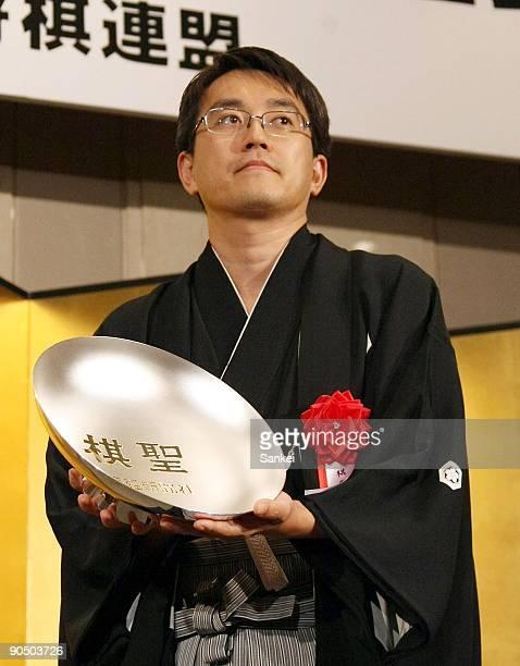 Japanese chess player Yoshiharu Habu poses for photographs during the 80th 'Kisei' Title Award Ceremony at Grand Prince Hotel Akasaka on September 7...