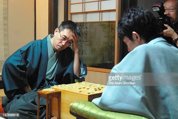 Japanese chess player Yoshiharu Habu speaks after beating Taichi Nakamura at the Kisei title on July 5 2012 in Gotsu Shimane Japan Habu won his 81st...