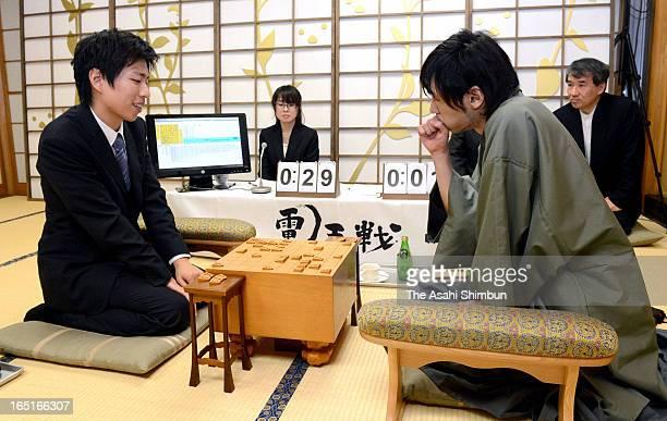 Japanese chess shogi master Shinichi Sato and shogi program 'Ponanza' developed by Issei Yamamoto compete at Shogi Kaikan on March 30 2013 in Tokyo...