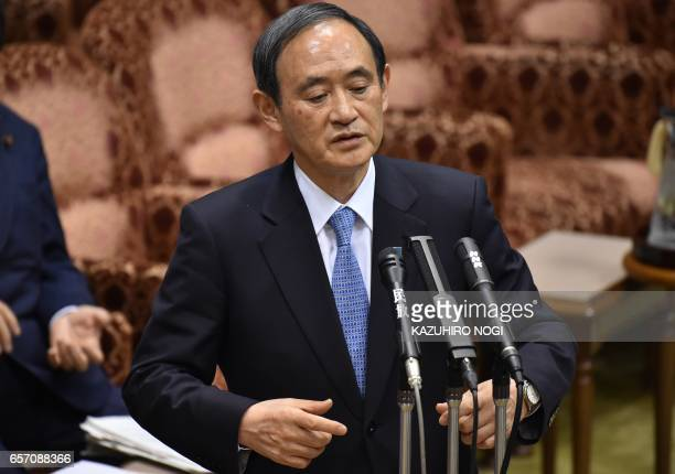 Japanese Chief Cabinet Secretary Yoshihide Suga answers questions during a budget committee session of the House of Councilors at the Parliament in...