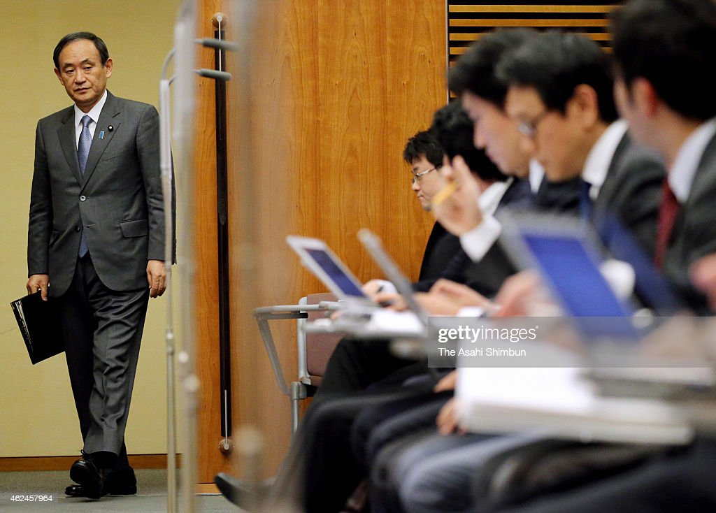 Japanese Chief Cabinet Secretary <a gi-track='captionPersonalityLinkClicked' href=/galleries/search?phrase=Yoshihide+Suga&family=editorial&specificpeople=3868279 ng-click='$event.stopPropagation()'>Yoshihide Suga</a> enters a conference room at Prime Minister Shinzo Abe's official residence on January 29, 2015 in Tokyo, Japan. A new message purportedly delivered by Islamic State hostage Kenji Goto threatens the execution of a Jordanian pilot if a prisoner swap involving Goto is not carried out by sunset on January 29 in Mosul, Iraq. The latest posting on the Internet was the fourth involving Goto. The video contained no photos or video images, only a still image of a message written in Arabic. A male voice reads the message translated into English.