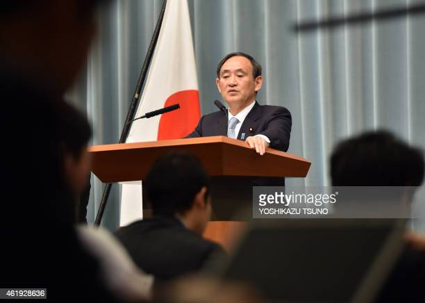 Japanese Chief Cabinet Secretary Yoshihide Suga gestures as he answers questions during a press conference at the prime minister's official residence...