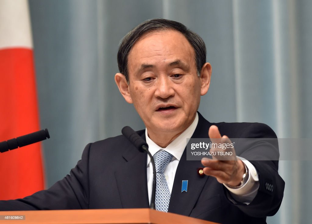 Japanese Chief Cabinet Secretary <a gi-track='captionPersonalityLinkClicked' href=/galleries/search?phrase=Yoshihide+Suga&family=editorial&specificpeople=3868279 ng-click='$event.stopPropagation()'>Yoshihide Suga</a> gestures as he answers questions during a press conference at the prime minister's official residence in Tokyo on January 22, 2015. Japan has been rocked by a video in which a black-clad jihadist from the Islamic State group demands 200 million USD for the lives of freelance journalist Kenji Goto and self-employed contractor Haruna Yukawa. AFP PHOTO / Yoshikazu TSUNO
