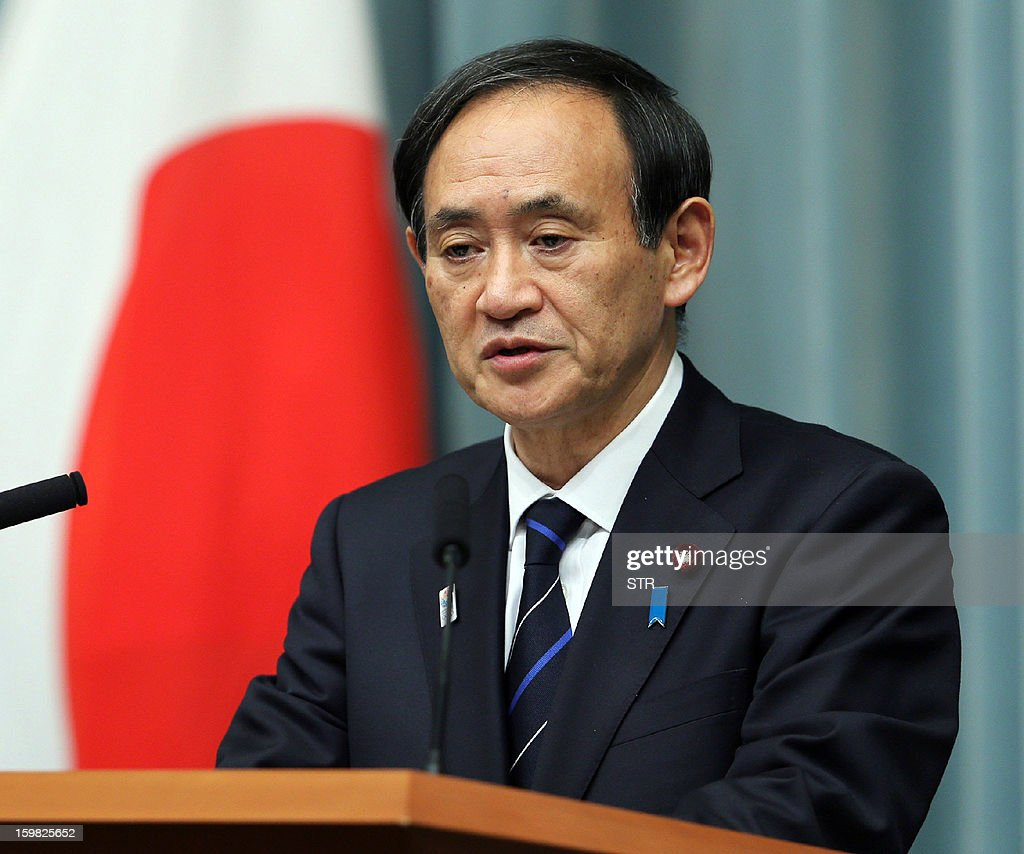 Japanese Chief Cabinet Secretary Yoshihide Suga speaks before press at the prime minister's official residence in Tokyo after a cabinet-level meeting to co-ordinate its response to hostage issues in Algeria on January 21, 2013. Suga said seven Japanese deaths had been confirmed in the Algerian hostage crisis, the first official confirmation from Tokyo that any of its nationals had died. AFP PHOTO / JIJI PRES JAPAN OUT
