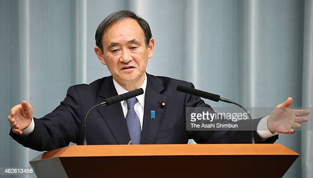 Japanese Chief Cabinet Secretary Yoshihide Suga speaks during a press conference at Prime Minister Shinzo Abe's official residence on February 1 2015...
