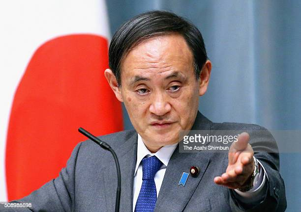 Japanese Chief Cabinet Secretary Yoshihide Suga speaks during the news conference held following North Korea's rocket launch at the Prime Minister's...