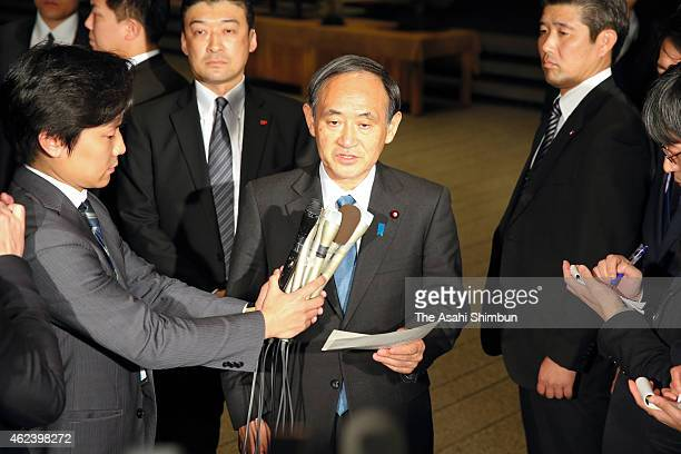 Japanese Chief Cabinet Secretary Yoshihide Suga speaks to media reporters about a new video posted on the internet at Prime Minister Shinzo Abe's...