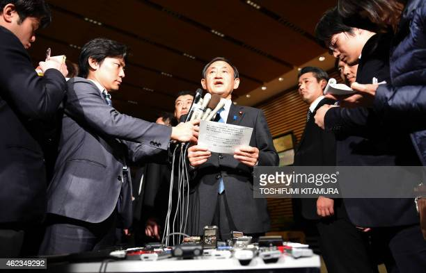 Japanese Chief Cabinet Secretary Yoshihide Suga speaks to reporters at the prime minister's official residence in Tokyo early on January 28 2015...