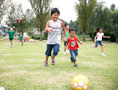Japanese children playing soccer