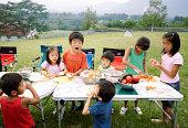 Japanese children preparing dinner