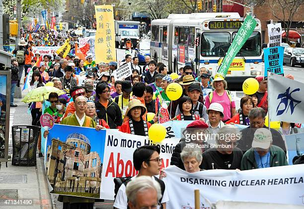 Japanese citizens join an antinuclear weapons rally on April 26 2015 in New York The rally is to mark the ninth Nuclear Nonproliferation Treaty...