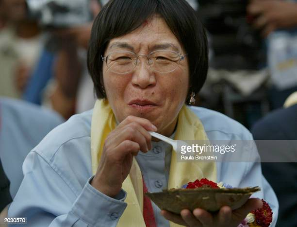 Japanese climber Junko Tabei the first woman to summit Mt Everest in 1975 reacts to eating the local Nepalese spicy food during the festivities at...
