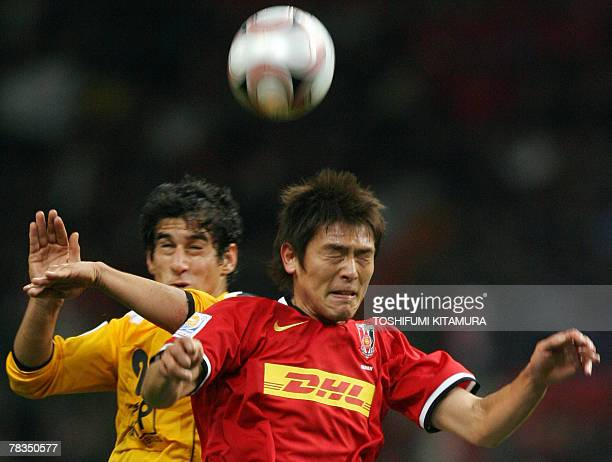 Japanese club team Urawa Reds midfielder Takahito Soma fights for the ball with Iranian Sepahan midfielder Ehsan Hajy Safi during their Club World...