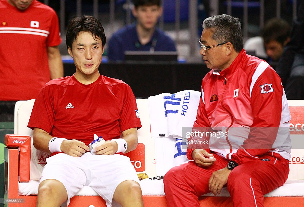 Japanese coach Minoru Ueda talks to <a gi-track='captionPersonalityLinkClicked' href=/galleries/search?phrase=Go+Soeda&family=editorial&specificpeople=699644 ng-click='$event.stopPropagation()'>Go Soeda</a> of Japan during their Davis Cup match against Vasek Pospisil of Canada March 8, 2015 in Vancouver, British Columbia, Canada. Pospisil won 3-0 and Canada defatted Japan 3-2.