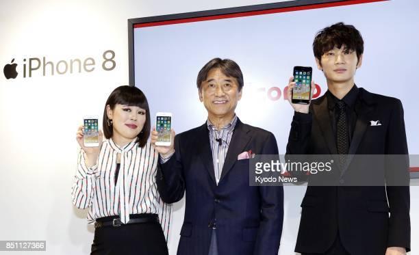 Japanese comedian Blouson Chiemi NTT Docomo Inc President Kazuhiro Yoshizawa and actor Go Ayano show Apple Inc's iPhone 8 smartphones in a launch...