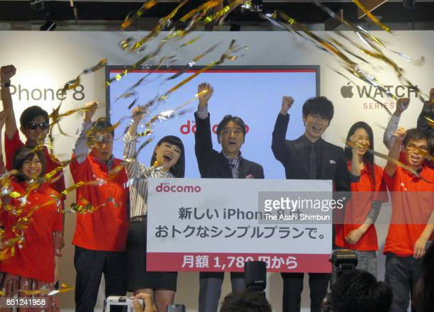 Japanese comedian Blouson Chiemi NTT Docomo Inc President Kazuhiro Yoshizawa and actor Go Ayano attend the iPhone 8 launching event on September 22...
