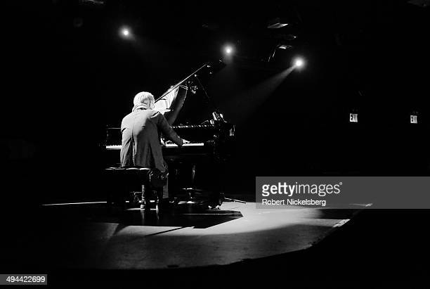 Japanese composer Ryuichi Sakamoto plays music he wrote for Linda Hoaglund's new documentary film 'The Wound and The Gift' May 10 2014 during a...