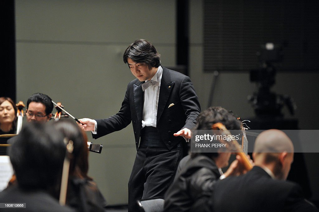 Japanese conductor Kazuki Yamada performs with the Yokohama Sinfonietta, on February 3, 2013, as part of the 'Folle Journee' music festival at the Cite des Congres in Nantes.