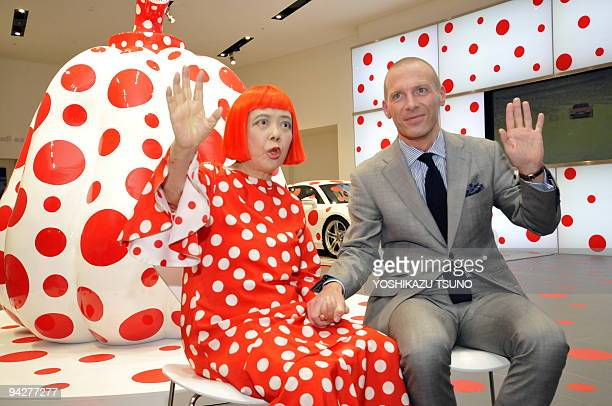Japanese contemporary artist Yayoi Kusama and Audi Japan president Dominique Boesch pose next to one of her art designs using a large pumpkin at an...