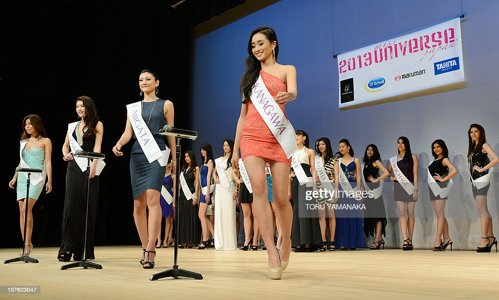 Japanese contestants from 44 prefectures step up to microphones to introduce themselves during a press event in Tokyo on December 5, 2012. One woman will be chosen to represent Japan on March 4, 2013 for the 2013 Miss Universe beauty pageant. AFP PHOTO/Toru YAMANAKA