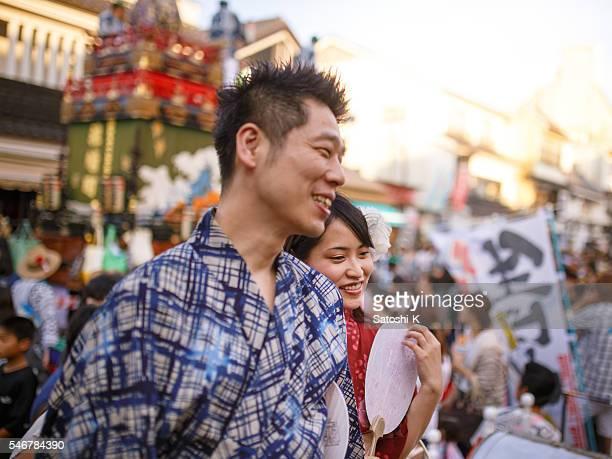 Japanese couple dating at Matsuri, wearing yukata