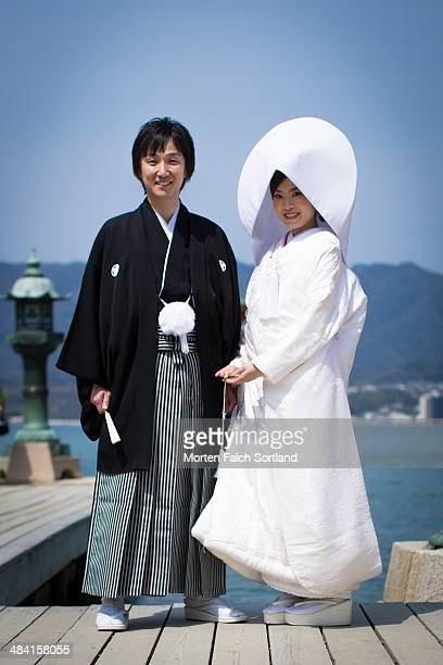 Japanese couple getting married at the temple at Miyajima Island just outside of Hiroshima Japan Not model released