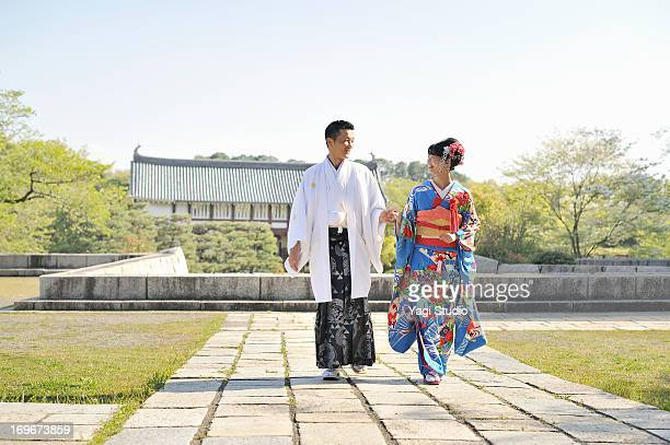 A Japanese couple in wedding kimonos
