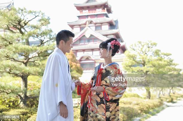 A Japanese couple in wedding kimonos