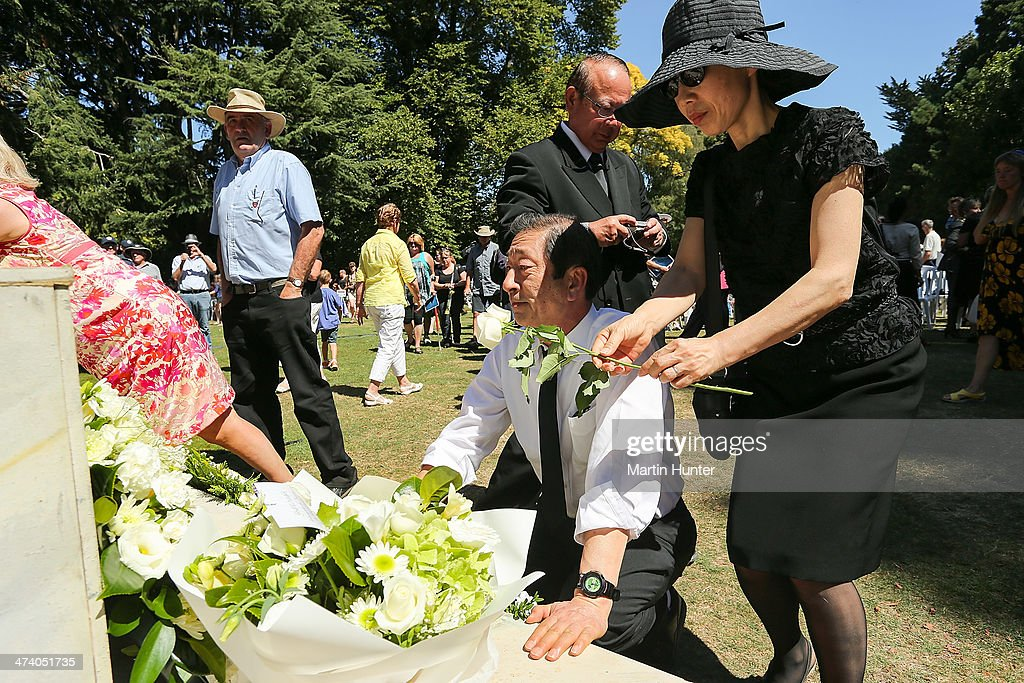 Japanese couple lay a wreath during a Civic Memorial Service held in the Botanical Gardens for victims of the 2011 Christchurch Earthquakes on February 22, 2014 in Christchurch, New Zealand. The earthquake measuring 6.3 in magnistude devastated Christchurch killing 185 people and causing an estimated $40 billion in damage to the city's buildings and infrastructure.