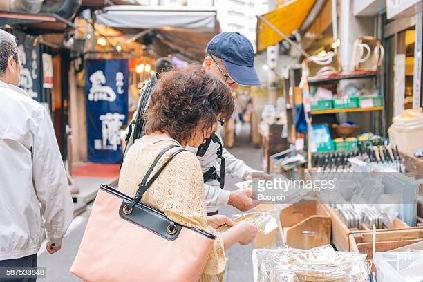 Japanese Couple Shopping Look at Merchandise Tokyo Tuskiji Fish Market