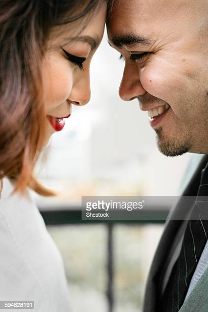 Japanese couple touching foreheads